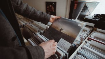 Person looking through albums.
