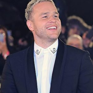 Olly with blonde hair