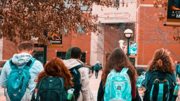 Students walking towards a college building