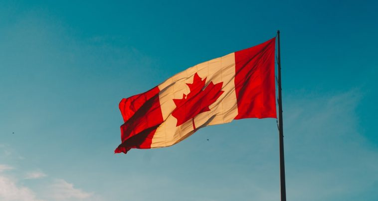 Canada flag waving in the sky.