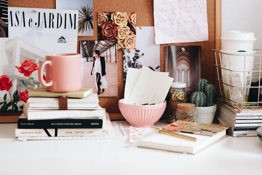 Desk filled with books and papers.