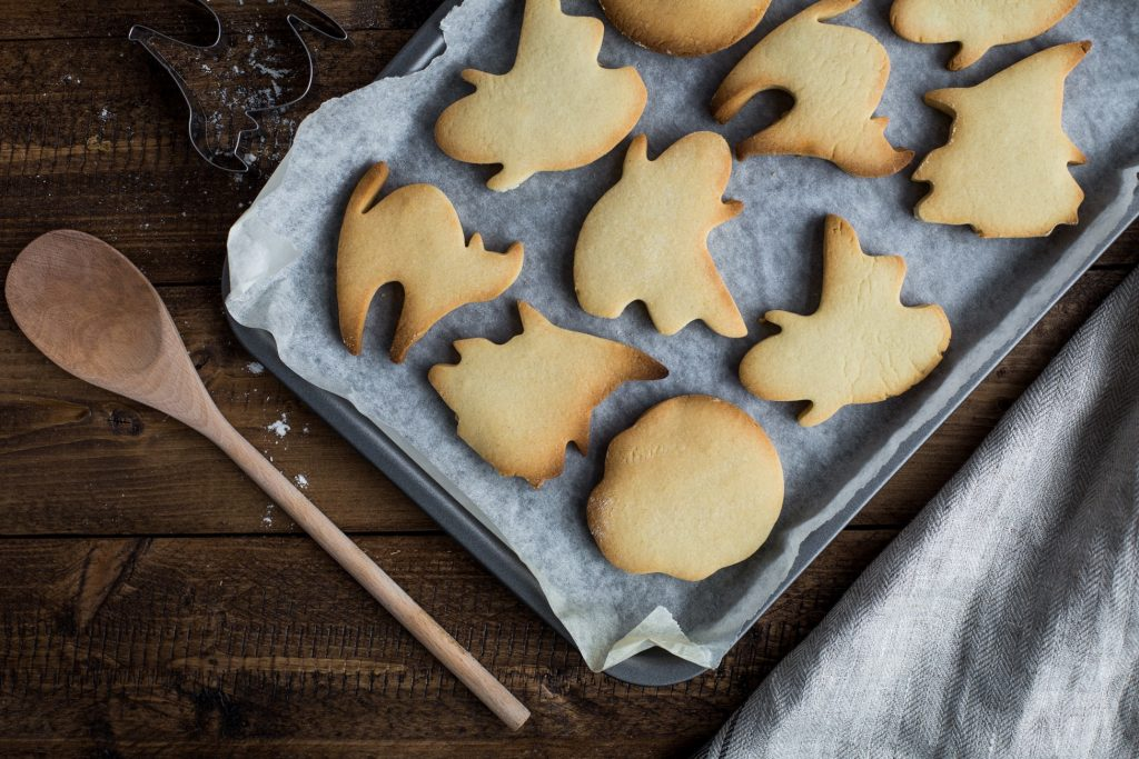 Cookies shaped like Halloween characters on a tray